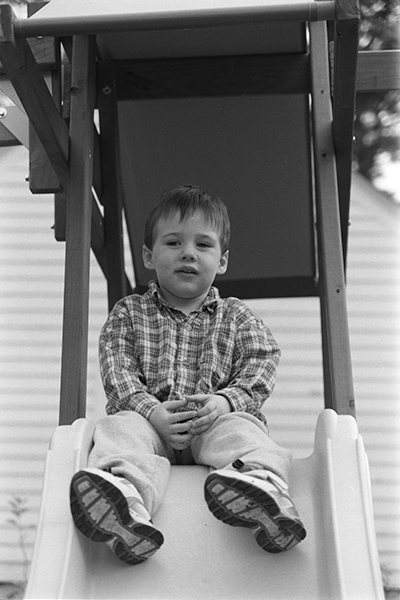 The full frame of my son, William, sitting on a slide. Delta 400 film shot on a Nikon N80. Unsure of the lens. Digitized with the D800E and Rodagon D 75mm f/4